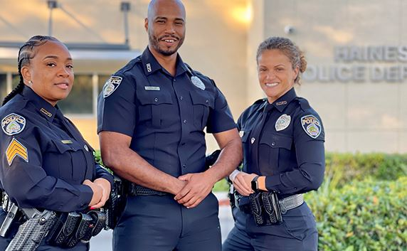 three police officers standing outside